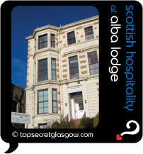 Top Secret Glasgow lozenge showing exterior in sun. Caption: scottish hospitality