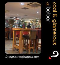 Top Secret Glasgow lozenge showing bar interior. Caption: cool & glamerous