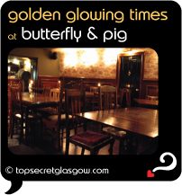 Top Secret Glasgow Quote Bubble showing interior of bar, tables & chairs. Caption: golden glowing times