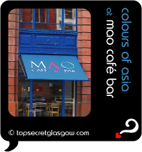 Top Secret Quote Bubble in black, with photo of Cafe Mao exterior, with prominent blue awning bearing logo.  Caption: 'colours of asia'