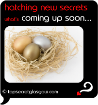 Top Secret Quote Bubble in black, nest of gold and silver eggs