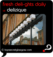 Top Secret Quote Bubble in black, with photo of logo above windows. Caption: 'fresh deli-ghts daily'