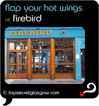 Top Secret Quote Bubble in black, with photo of logo and huge windows. Caption: 'flap your hot wings'