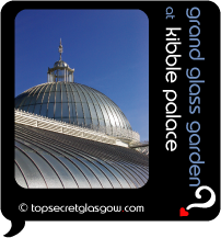 Top Secret Quote Bubble in black, with photo of main dome in sunshine of Kibble Palace. Caption: 'grand glass garden'