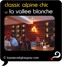Top Secret Quote Bubble in black, with photo of diners in glowing light. Caption: 'classic alpine chic'