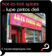 Top Secret Quote Bubble in black, with exterior shot of shop front. Caption: 'hot to trot spices at'