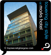 Top Secret Glasgow Quote Bubble showing impressive hotel exterior, in sun. Caption: towering city style