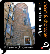 Top Secret Glasgow lozenge showing exterior stone curved tower. Caption: charm & character