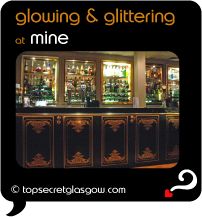 Top Secret Quote Bubble in black, with interior photo of polished, shining bar.  Caption: 'glowing & glittering'