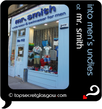 Top Secret Quote Bubble in black, with photo of  exterior Mr Smith;  pale blue painted front with products on mannequins in window.  Caption: 'into men's undies'