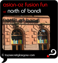 Top Secret Quote Bubble in black, with photo of Byres Road side of building with logo above windows. Caption: 'asian-oz fusion fun'