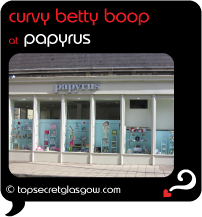 Top Secret Glasgow Quote Bubble showing sunny exterior of shop front.