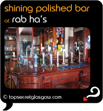 Top Secret Glasgow Quote Bubble showing interior, with bar in foreground. Caption: shining polished bar