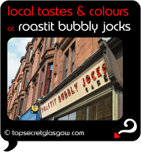 Top Secret Quote Bubble in black, with photo of big logo over windows, and tenements above. Caption: 'local tastes & colours'