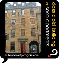 Top Secret Glasgow lozenge showing building from across street. Caption: classic old building