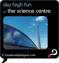 Top Secret Quote Bubble in black, with photo of exterior of Glasgow Science Centre and Millenium Tower, glass reflecting wispy clouds in a bright blue sky.  Caption: 'sky high fun'