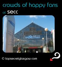 black speech bubble with SECC entrance against blue sky, caption: crowds of happy fans.