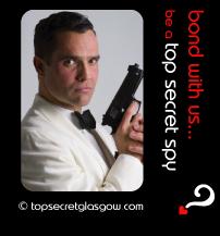 Top Secret Quote Bubble in black, with male spy in white tuxedo holding gun