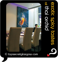 Top Secret Quote Bubble in black, with photo of dining room interior. Caption in mustard: 'exotic spicy tastes'