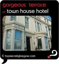 Top Secret Glasgow lozenge showing exterior in sun. Caption: gorgeous terrace