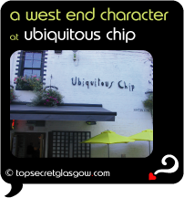 Top Secret Quote Bubble in black, with photo of exterior of Ubiquitous Chip, white walls with black trims, umbrellas in Ashton lane. 'a west end character'