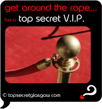 Top Secret Quote Bubble in black, with red velvet rope on gilded post.
