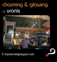 Top Secret Glasgow lozenge showing interior of cocktail bar.  Caption: charming & glowing