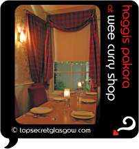 Top Secret Glasgow Quote Bubble showing interior of tiny dining room, with tartan curtains. Caption: haggis pakora