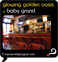 Top Secret Glasgow Quote Bubble showing interior of bar. Caption: golden glowing oasis