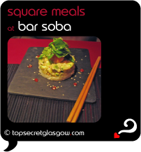 Top Secret Quote Bubble in black, with photo of bar soba asian fusion meal on square slate plate resting on black slatted mat on deep red table with chopsticks.  Caption: 'square meals'
