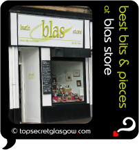 Top Secret Quote Bubble in black, with photo of exterior of Blas Store;  white with black trim, blackboard of specials, window display. Caption: 'best bits & pieces'
