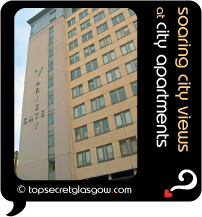 Top Secret Glasgow lozenge showing modern exterior in sun. Caption: soaring city views