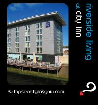 top secret quote bubble showing city inn exterior in sun; caption: riverside living