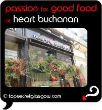 Top Secret Quote Bubble in black, with photo of window and hanging pots of flowers. Caption: 'passion for good food'