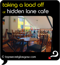 Top Secret Glasgow Quote Bubble showing charming cafe interior. Caption: taking a load off