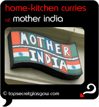 Top Secret Quote Bubble in black, with photo of close up of logo on side of building. Caption: 'home-kitchen curries'