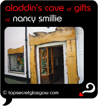 Top Secret Quote Bubble in black, with photo of main door and side window. Caption: 'aladdin's cave of gifts'
