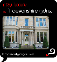 Top Secret Quote Bubble in black, with photo of front facade, in the sun. Caption: 'ritzy luxury'