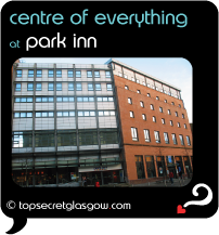 Top Secret Glasgow Quote Bubble showing hotel exterior in sun. Caption: centre of everything