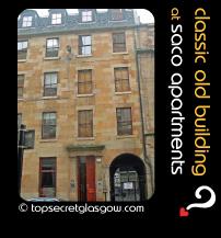 Top Secret Glasgow lozenge showing building from across street. Caption: classic old building