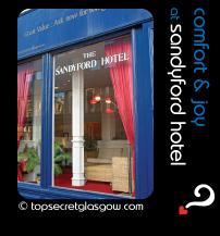 Glasgow lozenge side, external view into reception. Caption: comfort & joy