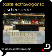 Top Secret Quote Bubble in black, with exterior shot of shop front, shelves in window. Caption: 'taste extravaganza'