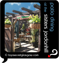 Top Secret Quote Bubble in black, with photo of the cute outdoors garden-patio dining area. Caption: 'patio dining'
