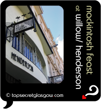 Top Secret Quote Bubble in black, with photo of Henderson exterior, looking up the building to blue sky and with view of signs for Henderson and The Willow Tearoom.  Caption: 'mackintosh feast''