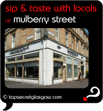 Top Secret Quote Bubble in black, with photo of corner, showing bar and restaurant windows. Caption: 'sip & taste with locals'